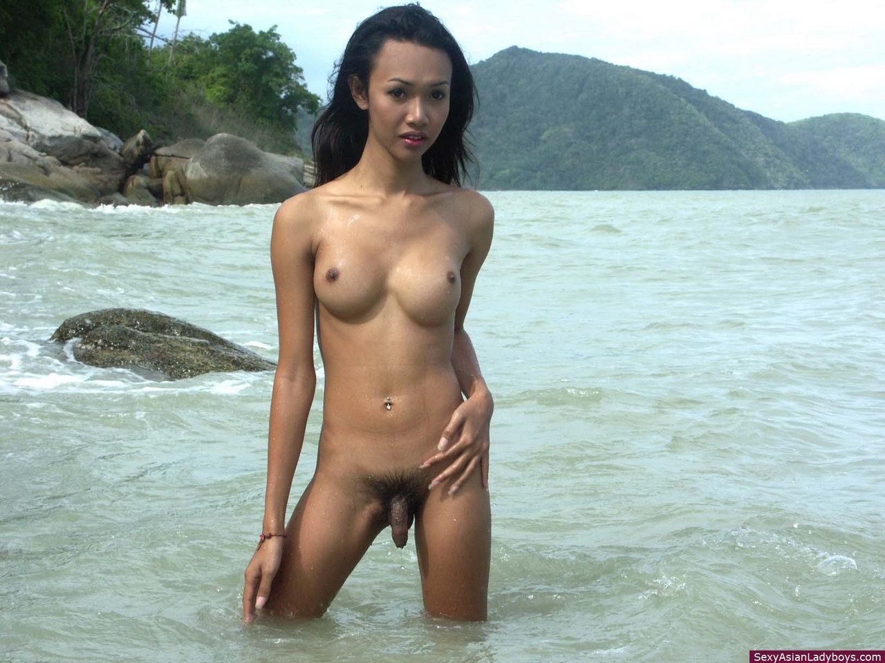 Nude beach girl plays with penis